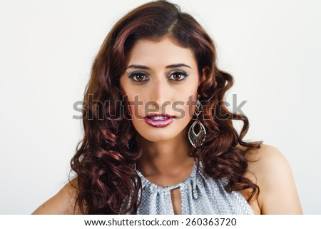 Beautiful Woman Wearing Diamond Earrings - stock photo