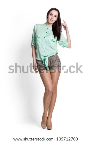 Beautiful woman wearing green blouse with emotions - stock photo