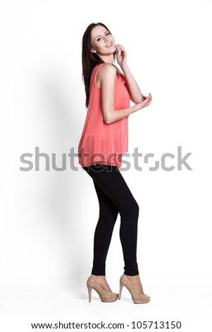 Beautiful woman wearing in red with emotions - stock photo
