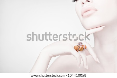 beautiful woman wearing jewelry, high key, clean image with copy space - stock photo