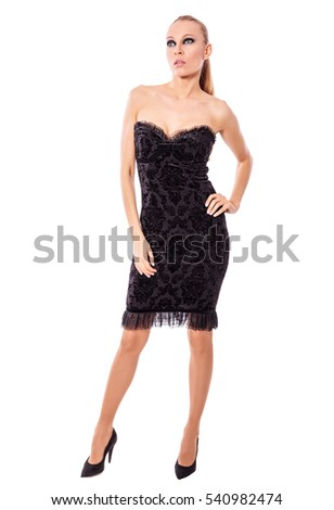 beautiful woman wearing little black dress standing isolated