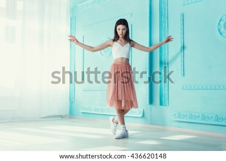 Beautiful woman wearing nice clothes, handbag posing on turquoise background. Fashion spring photo. Modern young fashionable lady in pastel colors - stock photo