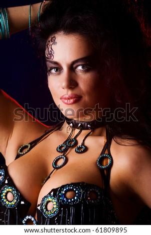 Beautiful woman wearing tribal makeup and dress - stock photo