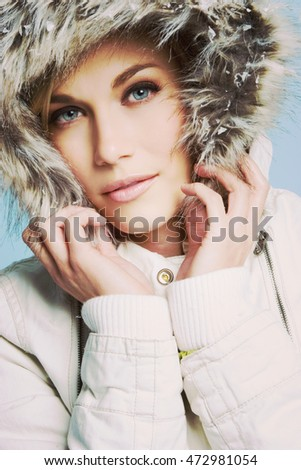 Beautiful woman wearing winter coat
