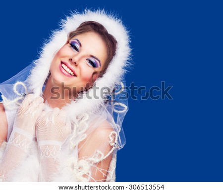 beautiful woman , winter topic, isolated against blue background - stock photo