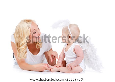 Beautiful woman with a baby angel. beautiful mother with angelic baby.  - stock photo