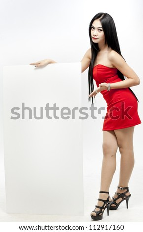 Beautiful woman with a banner - stock photo