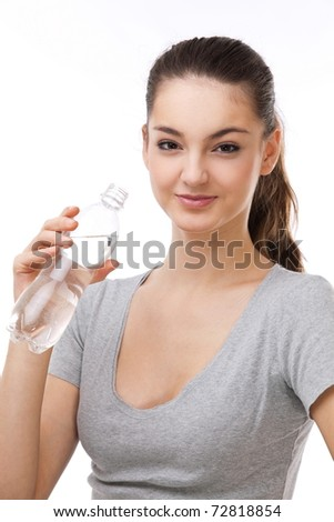 Beautiful woman with a bottle of fresh water. On a white background.
