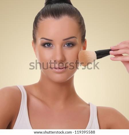 beautiful woman with a brush - stock photo