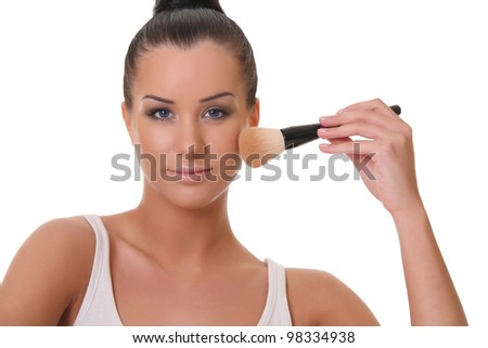 beautiful woman with a brush for powder - stock photo
