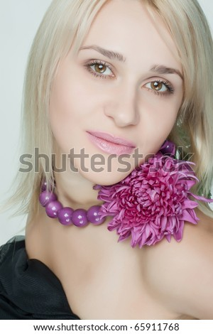 beautiful woman with a flower on a light background