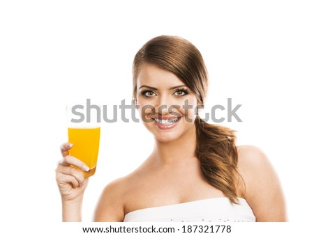 Beautiful woman with a glass of orange juice, isolated on white