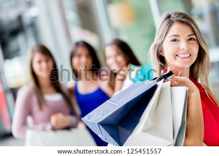 Beautiful woman with a group of shopping girls