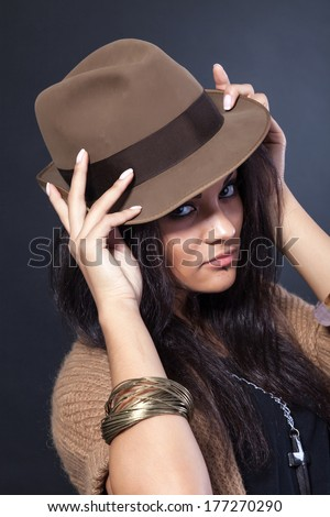 Beautiful woman with a hat  on a black backround