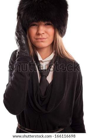 Beautiful woman with a headache wearing a fur hat, black gloves and tie