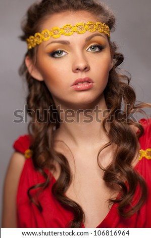 beautiful woman with a hoop on the head - stock photo