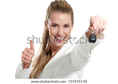 beautiful woman with a keys car on white background - stock photo