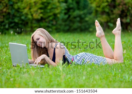 Beautiful woman with a laptop - stock photo