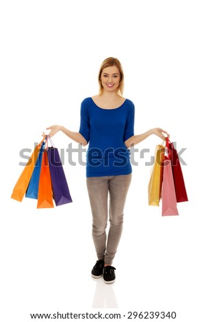 Beautiful woman with a lot of shopping bags. - stock photo