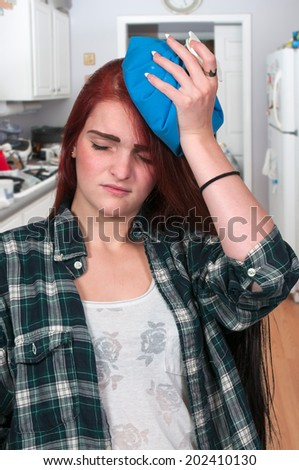 Beautiful woman with a painful pounding headache - stock photo