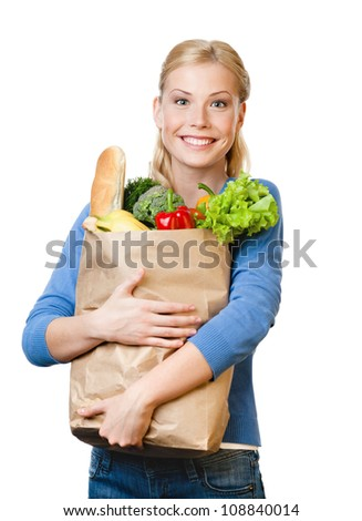 Beautiful woman with a paper bag full of healthy eating, isolated on white