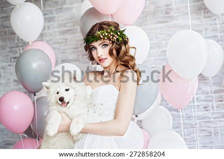 Beautiful woman with a Samoyed dog - stock photo