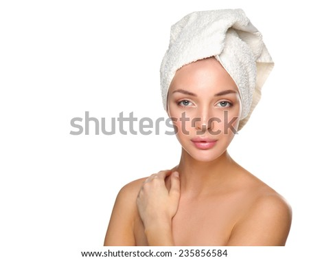 beautiful woman with a towel on his head on a white background - stock photo
