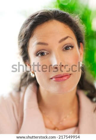 Beautiful woman with a wondering face - close up. - stock photo
