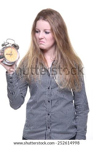 Beautiful woman with alarm clock - stock photo