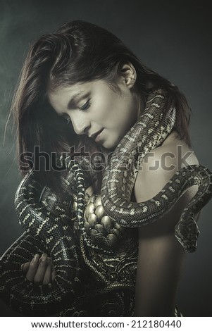 beautiful woman with an Australian python - stock photo