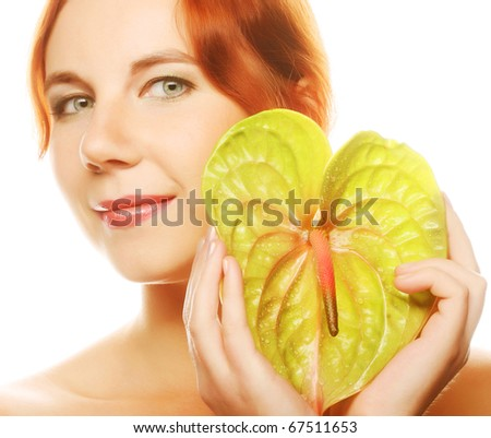 Beautiful woman with anthurium. - stock photo