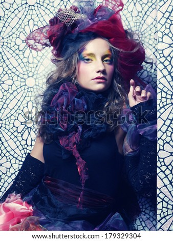 Beautiful woman with artistic make-up. Princess style. - stock photo