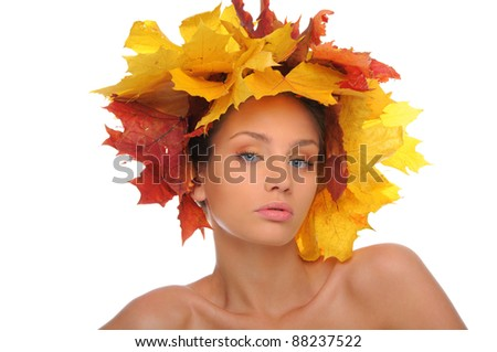 Beautiful woman with autumn leaves isolated on white