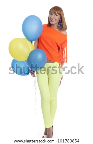 Beautiful woman with balloons in the studio