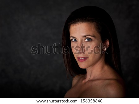 Beautiful woman with bare shoulders studio portrait - stock photo