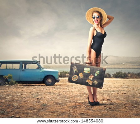 beautiful woman with bathing suit, straw hat and vintage suitcase - stock photo