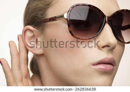 Beautiful woman with big black glasses-close up - stock photo