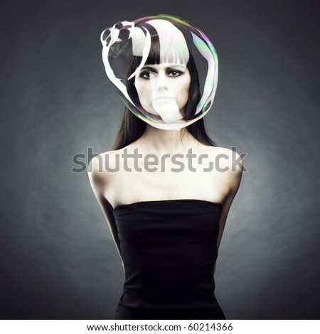 Beautiful woman with big soap bubble. Conceptual photo