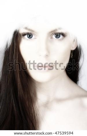 Beautiful woman with big white fur hat. High key. - stock photo