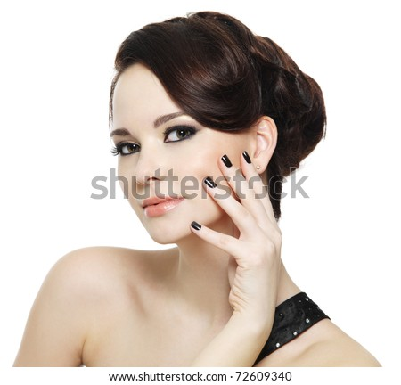 beautiful woman with black nails and bright eye make-up - on white background - stock photo