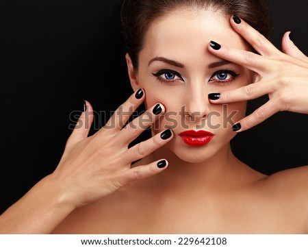 Beautiful woman with black nails looking sexy with empty copy space background. Closeup - stock photo