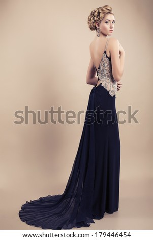 beautiful woman with blond hair in long elegant black dress - stock photo