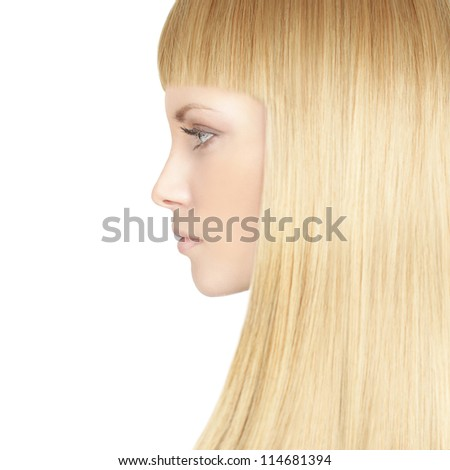 Beautiful woman with blond healthy hair - beauty salon background - stock photo
