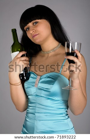 Beautiful Woman With bottle of red wine