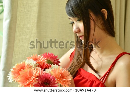 Beautiful woman with bouquet flowers