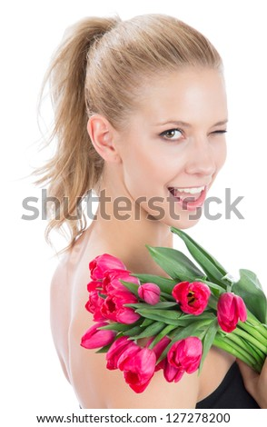 Beautiful woman with bouquet of red tulips flowers smiling and looking at the corner isolated on white background - stock photo