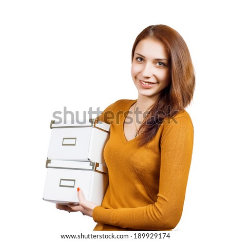 Beautiful woman with boxes over white - stock photo