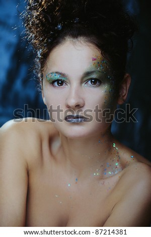 Beautiful woman with bright makeup for New Year or Christmas party