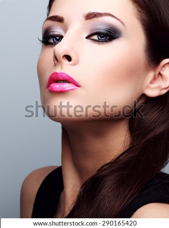 Beautiful woman with bright smokey makeup eyes and pink lipstick. Perfect closeup make-up and foundation - stock photo