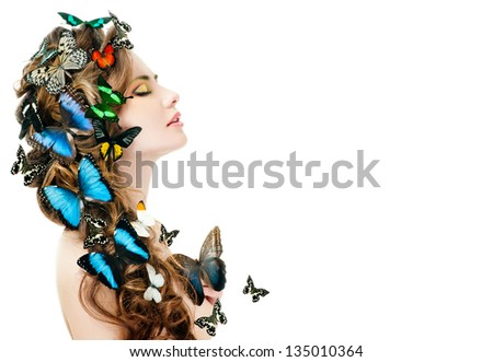 beautiful woman with butterflies in her hair - stock photo